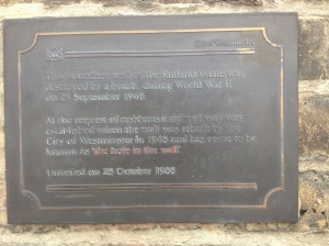 Closeup of plaque explaining history of the hole in the wall